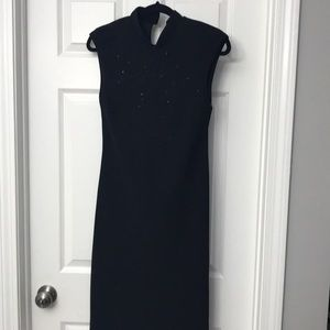 Oriental style black dress with bead accents